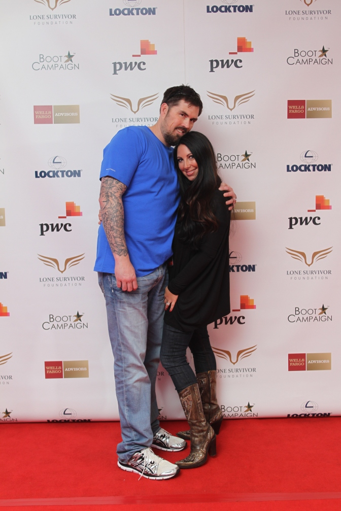 Marcus Luttrell, subject of the film and his wife Melanie pose for a photo on the red carpet.